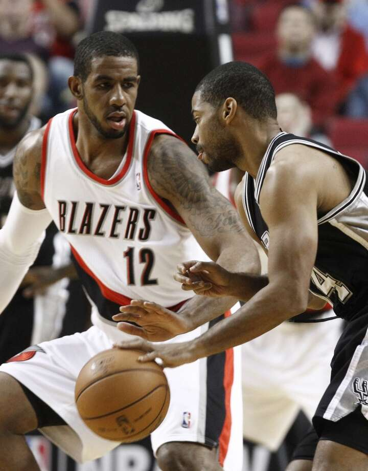 San Antonio Spurs guard Gary Neal, right, drives on Portland Trail Blazers forward LaMarcus Aldridge during the first quarter of an NBA basketball game in Portland, Ore., Thursday, Dec. 13, 2012. (AP Photo/Don Ryan) (Associated Press)