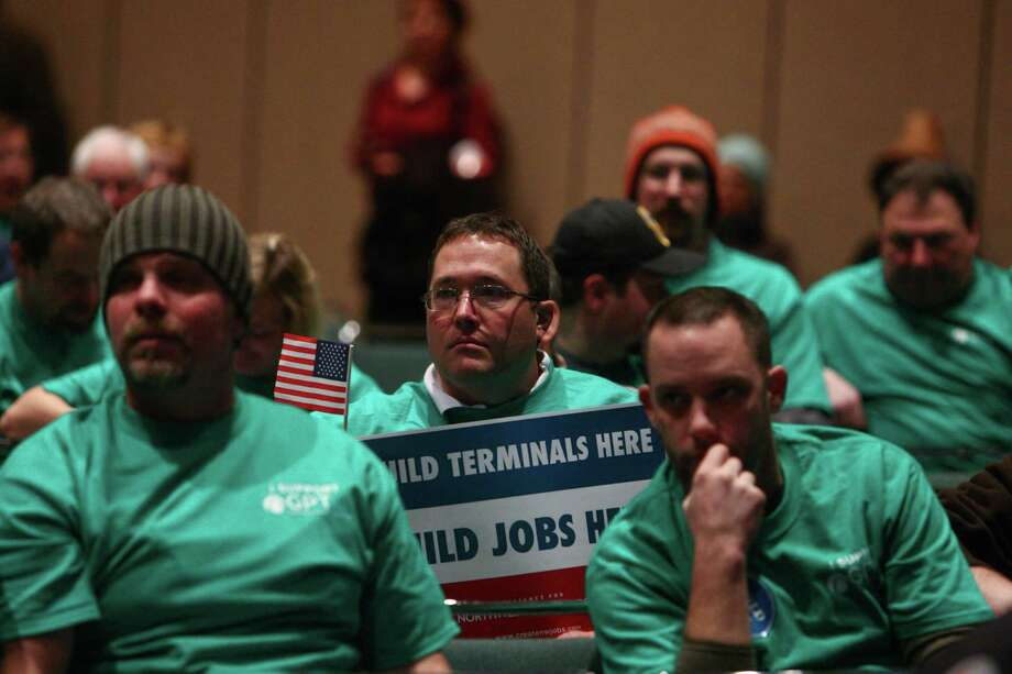 Supporters are shown during a scoping meeting about the proposed Cherry Point coal export terminal in Whatcom County. The supporters of the facility wore green T-shirts during the meeting. Photo: JOSHUA TRUJILLO / SEATTLEPI.COM