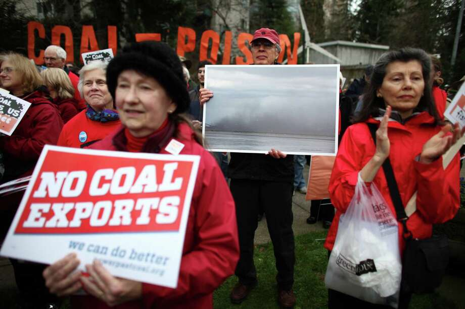 Opponents gather in Freeway Park for a rally before a scoping meeting about the proposed Cherry Point coal export terminal. Photo: JOSHUA TRUJILLO / SEATTLEPI.COM