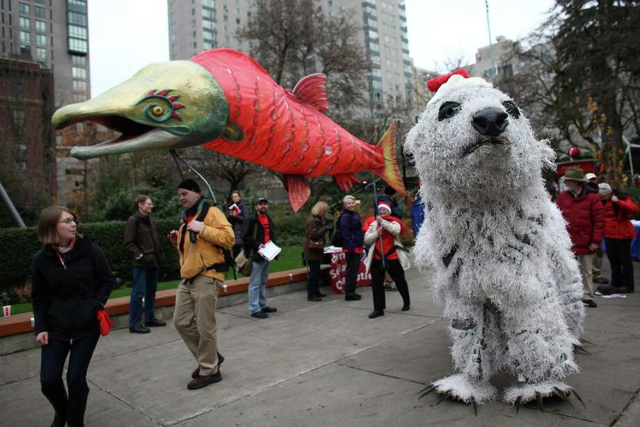 A salmon puppet and a polar bear puppet created by The Backbone Campaign are shown before a scoping meeting about the proposed Cherry Point coal export terminal in Whatcom County. Opponents gathered for a rally in Freeway Park before the meeting. Photo: JOSHUA TRUJILLO / SEATTLEPI.COM