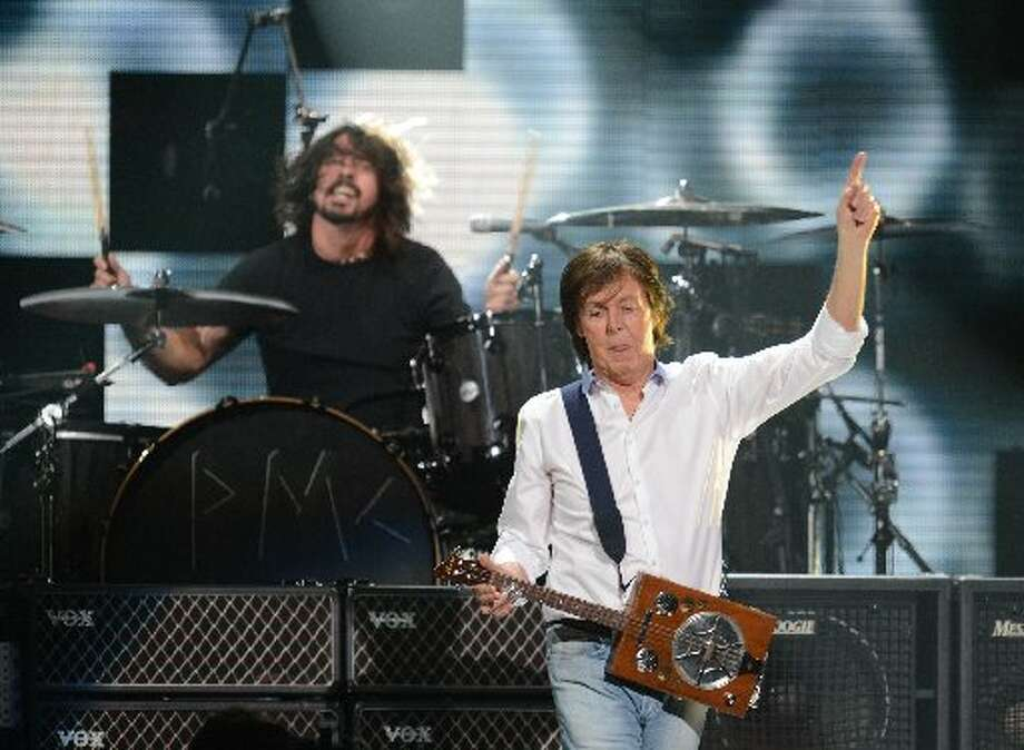 Paul McCartney performs on stage during 12-12-12 ~ The Concert For Sandy Relief December 12, 2012 at Madison Square Garden in New York. AFP PHOTO/DON EMMERTDON EMMERT/AFP/Getty Images