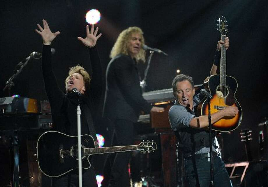 Jon Bon Jovi (L) and Bruce Springsteen (R) perform during 12-12-12 ~ The Concert ForSandy Relief December 12, 2012 at Madison Square Garden in New York. AFP PHOTO/DON EMMERTDON EMMERT/AFP/Getty Images