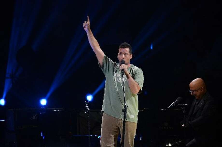 Comedian and actor Adam Sandler performs during 12-12-12 ~ The Concert ForSandy Relief December 12, 2012 at Madison Square Garden in New York. AFP PHOTO/DON EMMERTDON EMMERT/AFP/Getty Images