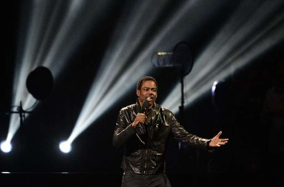 Comedian Chris Rock performs during 12-12-12 The Concert For Sandy Relief December 12, 2012 at Madison Square Garden in New York. AFP PHOTO/DON EMMERTDON EMMERT/AFP/Getty Images