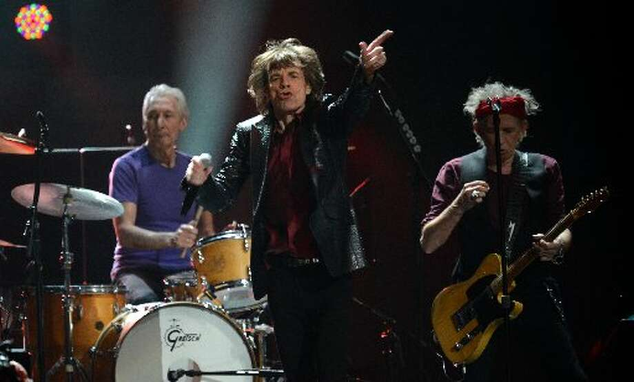The Rolling Stones, Charlie Watts (L), Mick Jagger (C) and Keith Richards (R) perform during 12-12-12 The Concert For Sandy Relief December 12, 2012 at Madison Square Garden in New York. AFP PHOTO/DON EMMERTDON EMMERT/AFP/Getty Images