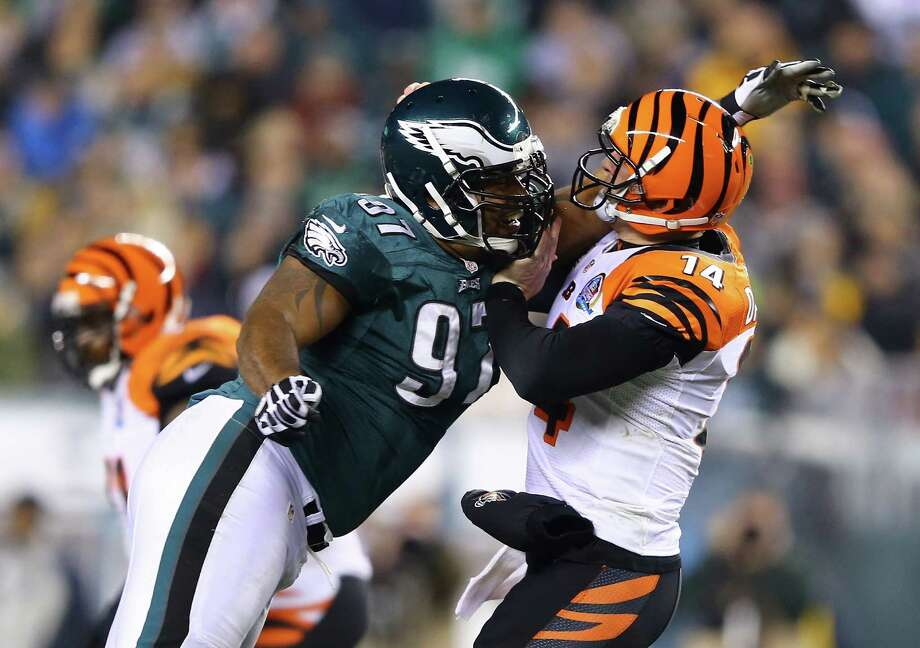 PHILADELPHIA, PA - DECEMBER 13:   Cullen Jenkins #97 of the Philadelphia Eagles pressures  Andy Dalton #14 of the Cincinnati Bengals during their game at Lincoln Financial Field on December 13, 2012 in Philadelphia, Pennsylvania.  (Photo by Al Bello/Getty Images) Photo: Al Bello / 2012 Getty Images