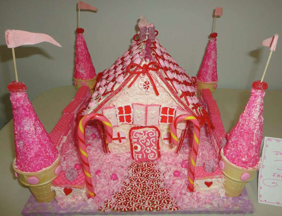 This pink gingerbread house was created by the Dear family of Westport for the first gingerbread house decorating contest sponsored by the Westport-Weston Chamber of Commerce.  Westport CT 12/13/12 Photo: Meg Barone / Westport News freelance