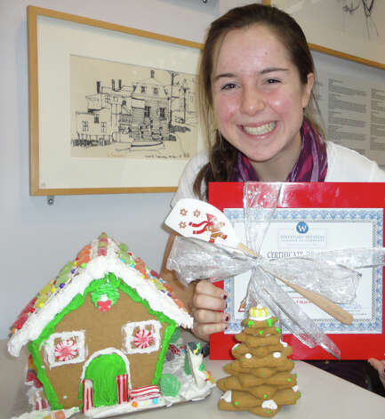 Madeline Gray, 14, of Westport took second place honors for the gingerbread house that she decorated for the first gingerbread house decorating contest sponsored by the Westport-Weston Chamber of Commerce.  Westport CT 12/13/12 Photo: Meg Barone / Westport News freelance