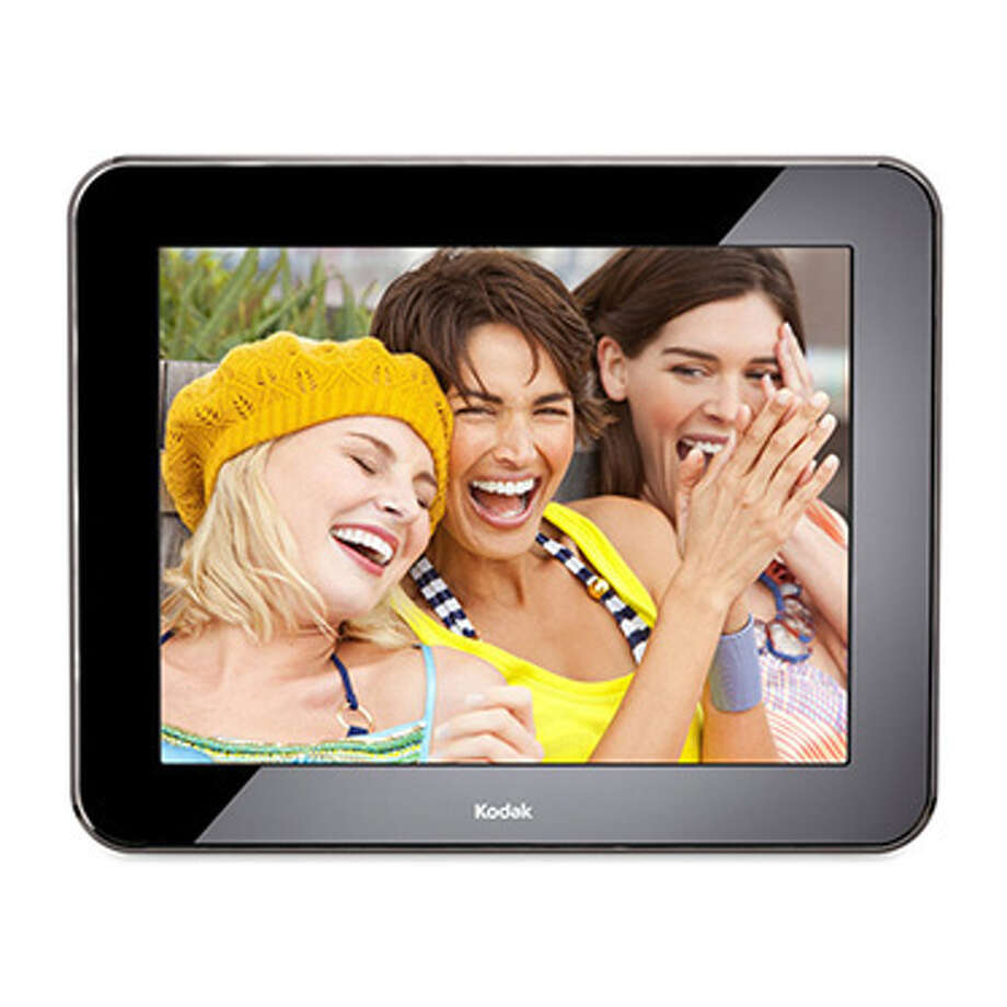 """Kodak Pulse 10"""" Digital Photo FrameAgain: moms and photos go hand in hand. And at this point, we're all taking far too many of them to ever print. Load the most memorable shots into a Kodak Pulse digital photo frame for her. If mom doesn't want to fidget with USB cables or SD cards, she can just load them via the Web or by e-mailing pictures directly from a phone. Photo: Contributed Photo"""