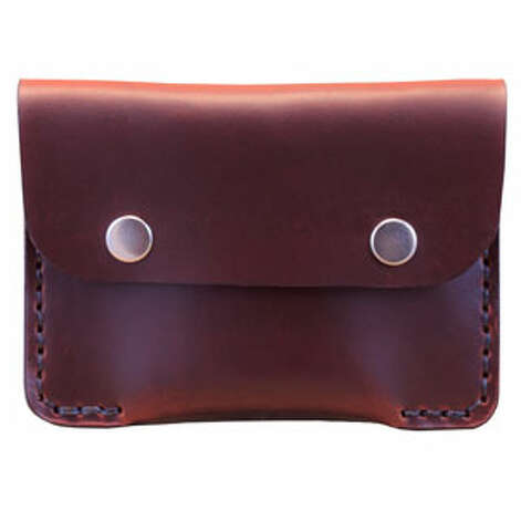A Card CaseA slim suit requires a slimmer wallet.Tan double snap slim Horween wallet ($55) by Chester Mox chestermox.com Photo: Contributed Photo