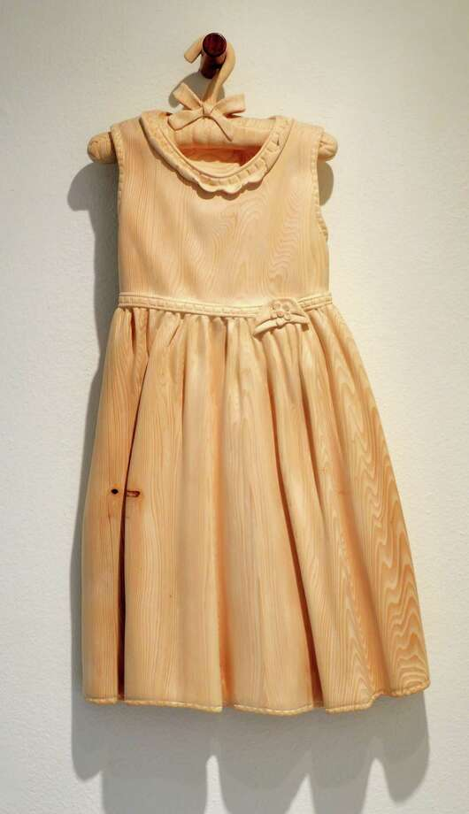 """Chris Hedrick's """"Easter Dress,"""" left, and """"For Funerals and Weddings,"""" both made of Alaskan yellow cedar and walnut, are on display at d.m. allison art through Dec. 28. Photo: D.m. Allison Art"""