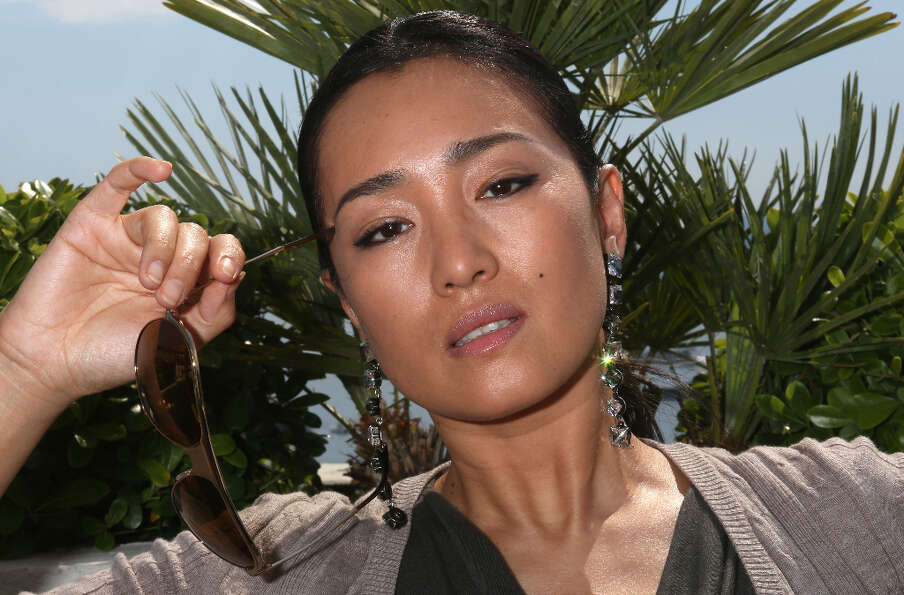 Gong Li during a photo session at the Cannes film festival on May 26, 2012.  A face that needs no ad