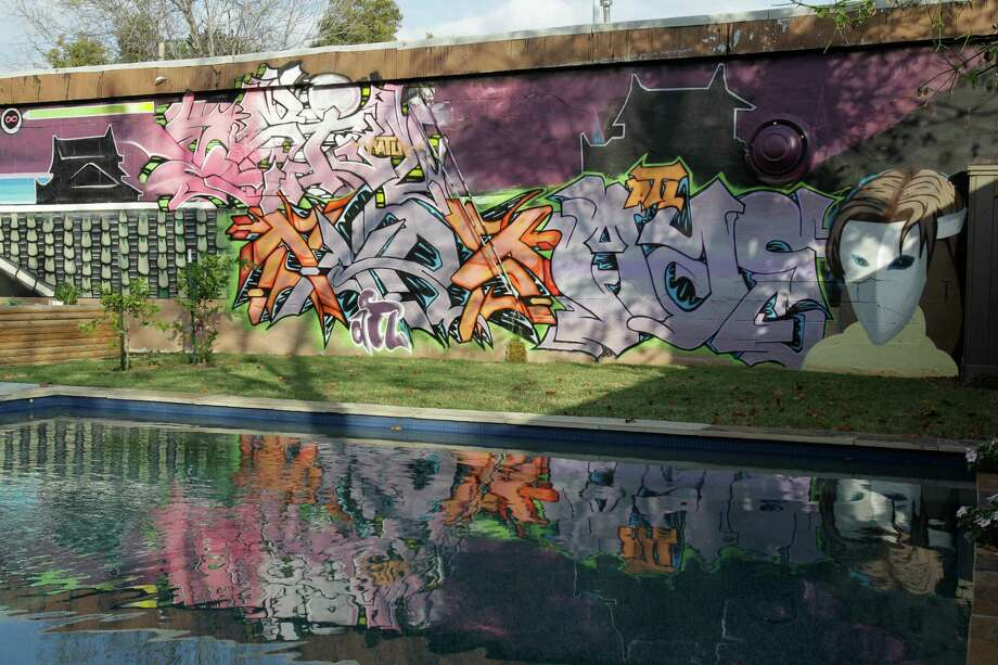Pool and graffiti wall in backyard shown Thursday, Dec. 6, 2012, in Houston. ( Melissa Phillip / Houston Chronicle ) Photo: Melissa Phillip, Staff / © 2012 Houston Chronicle