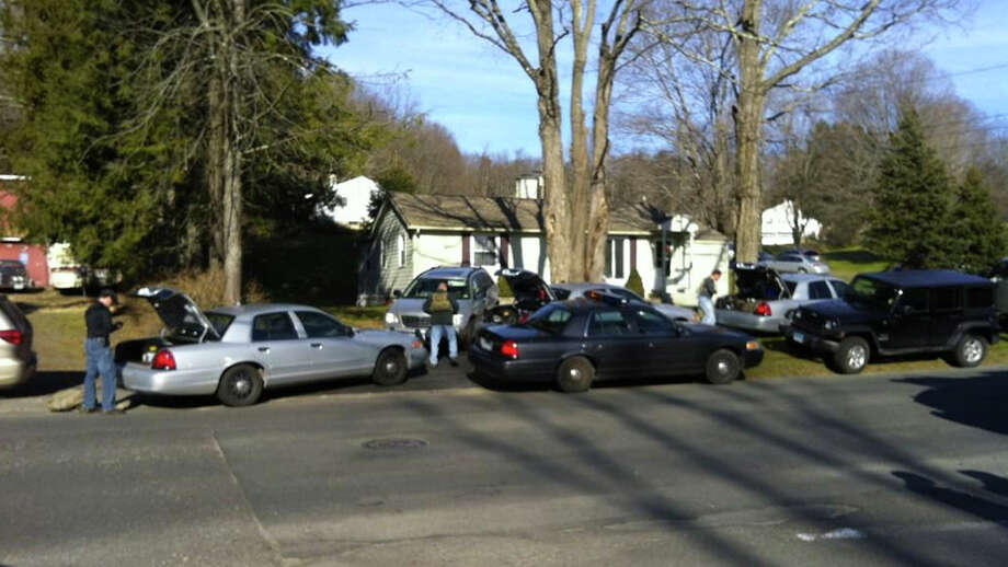 Authorities respond to a report of a shooting at Sandy Hook Elementary School in Newtown, Conn. Photo: Libor Jany, News-Times