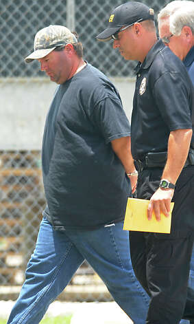 Travis Wade Smith is escorted Friday into the Jefferson County Jail under charges of murder. Smith surrendered to the Nederland police shortly after the shooting of Hollie Crenshaw at Around the Clock Daycare early Friday morning.   Photo taken Friday, May 25, 2012 Guiseppe Barranco/The Enterprise Photo: Guiseppe Barranco, STAFF PHOTOGRAPHER / The Beaumont Enterprise