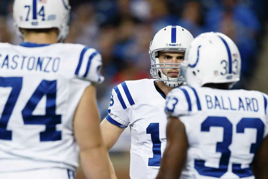 Indianapolis Colts quarterback Andrew Luck, center, talks to tackle Anthony Castonzo (74) and Indianapolis Colts running back Vick Ballard (33) during an NFL football game at Ford Field in Detroit, Sunday, Dec. 2, 2012. (AP Photo/Rick Osentoski) Photo: Rick Osentoski, Associated Press / FR170444 AP