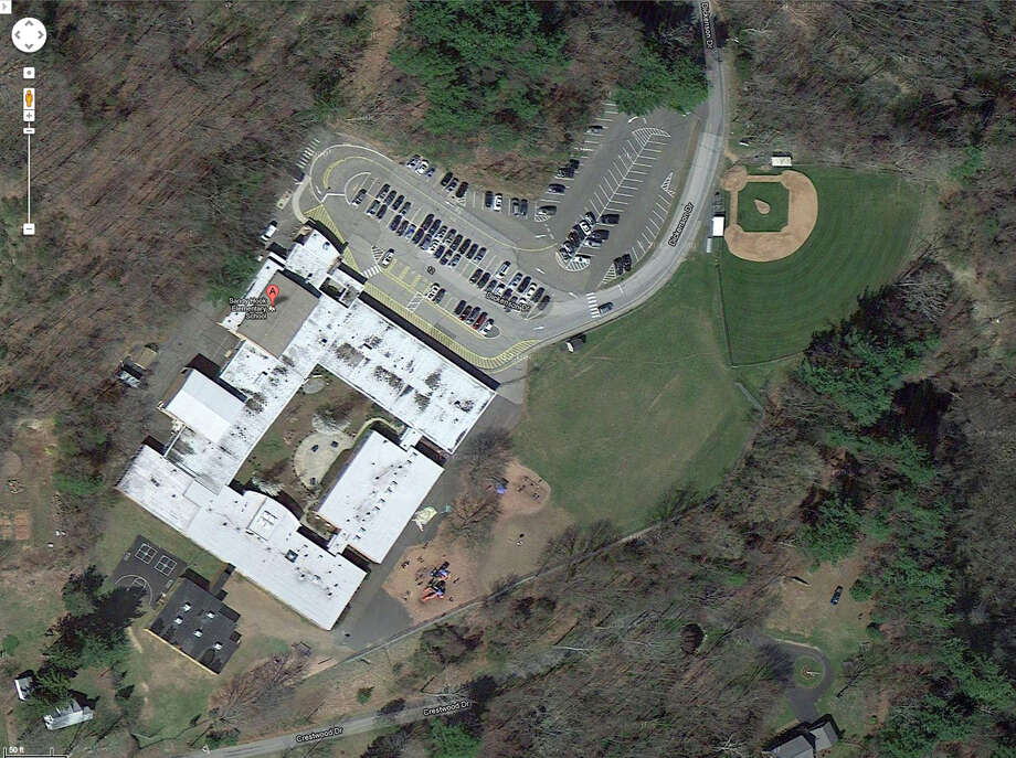This satellite image provided by Google shows the Sandy Hook Elementary School in Newtown, Conn. A shooting at the school Friday, Dec. 14, 2012, left the gunman dead and at least one teacher wounded. (AP Photo/Google) Photo: Associated Press / Google