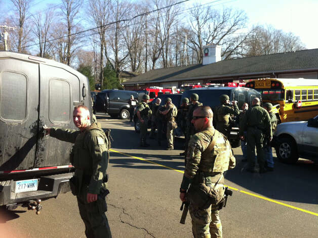 SWAT team officers on scene at Sandy Hook Fire Station as part of the response to a multiple shootings at Sandy Hook Elementary School in Newtown, Conn. on  Friday, Dec. 14, 2012. Photo: Michael Duffy / The News-Times