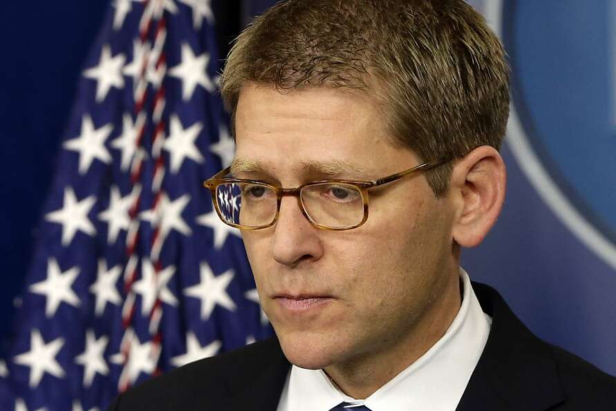 White House press secretary Jay Carney listens to a follow up question regarding the school shooting