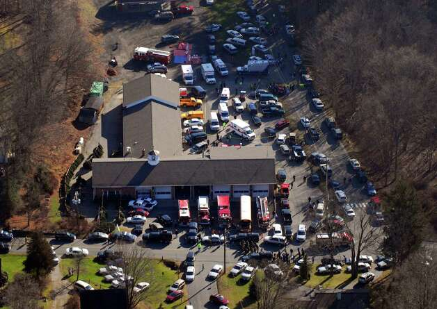 First responders converge at Sandy Hook Fire Department near Sandy Hook Elementary School in Newtown, Conn. Dec. 14, 2012. Twenty children and six teachers were killed in the school shooting at Sandy Hook Elementary School. Photo: Morgan Kaolian, Morgan Kaolian/AEROPIX / Connecticut Post Freelance