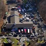 First responders converge at Sandy Hook Fire Department near Sandy Hook Elementary School in Newtown, Conn. Dec. 14, 2012. Twenty children and six teachers were killed in the school shooting at Sandy Hook Elementary School.