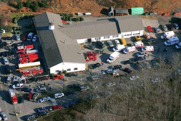 First responders and families converge at the Sandy Hook Firehouse near Sandy Hook Elementary School in Newtown, Conn., on Friday, Dec. 14, 2012. Photo: Morgan Kaolian, Morgan Kaolian/AEROPIX / Connecticut Post Freelance