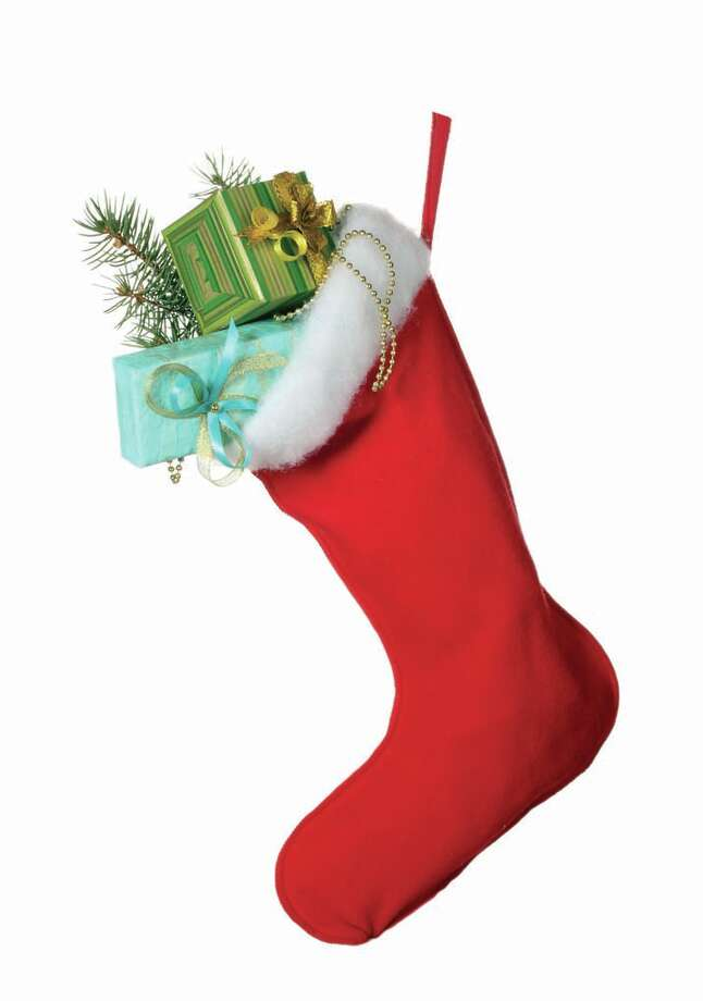 How do you fill a Christmas stocking? / Africa Studio - Fotolia