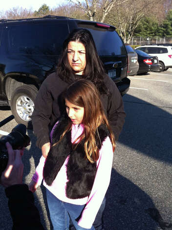 Sandy Hook Elementary School student Venesa Bajraliu and her mom Alberta Bajraliu near the scene of the fatal shooting at the school in Newtown, Conn. on Friday, Dec. 14, 2012. Twenty-seven people including 18 children were massacred in a horrific bloodbath at the Sandy Hook Elementary School this morning, sources told the Associated Press. Few other details were immediately available, and other reports contradicted those numbers. Photo: Michael Duffy / The News-Times