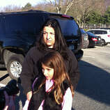 Sandy Hook Elementary School student Venesa Bajraliu and her mom Alberta Bajraliu near the scene of the fatal shooting at the school in Newtown, Conn. on Friday, Dec. 14, 2012. Twenty-seven people including 18 children were massacred in a horrific bloodbath at the Sandy Hook Elementary School this morning, sources told the Associated Press. Few other details were immediately available, and other reports contradicted those numbers.