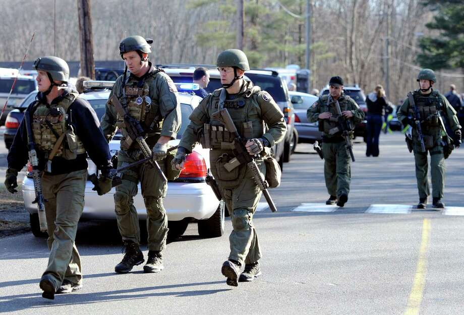 State Police at the scene of a multiple shooting at Sandy Hook Elementary School in Newtown, Conn., on Friday, Dec. 14, 2012. Photo: Associated Press