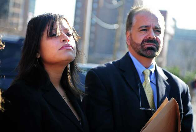 Incoming state Rep. Christina Ayala and her attorney Guy Soares make a statement outside Superior Court in Bridgeport Friday, Dec. 14, 2012. Photo: Autumn Driscoll / Connecticut Post