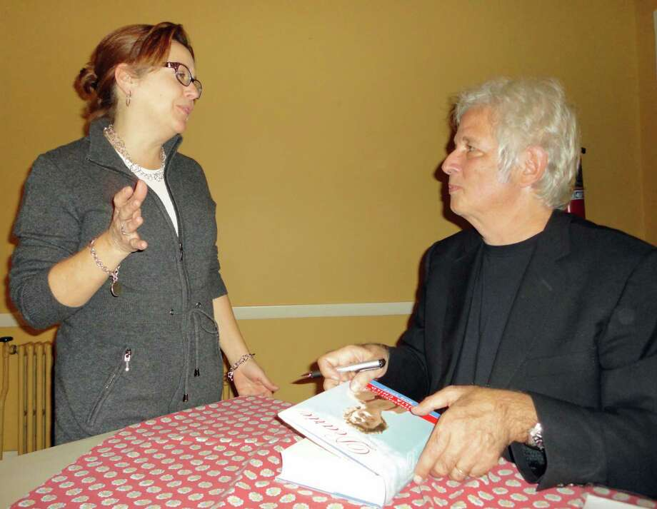 Maria Reina, a personal chef and caterer, talks with author Bob Spitz and has him autograph his book about Julia Child. Photo: Meg Barone