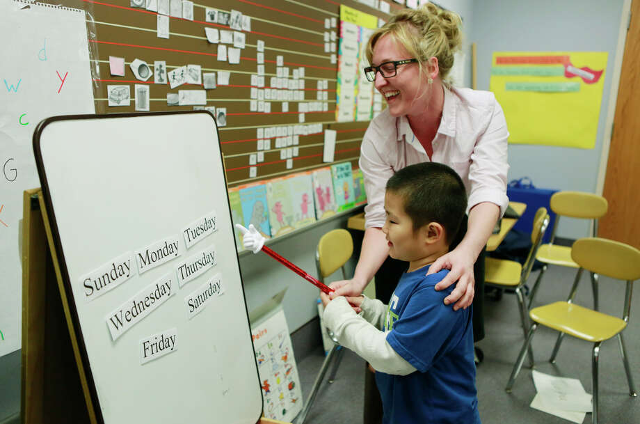 "English as a Second Language (ESL) teachers are in demand, for adults and children to learn English in Houston and experience everything our city has to offer. ""I would like to think that my teaching job will never be 100 percent replaced by a computer,"" writes one reader.  Photo: Jeremy Hogan, Associated Press / Bloomington Herald-Times"