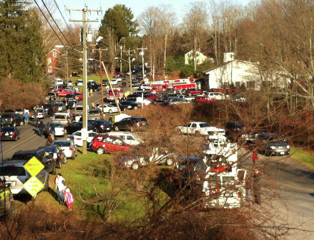 First responders and families converge at the Sandy Hook Firehouse near Sandy Hook Elementary School in Newtown, Conn., on Friday, Dec. 14, 2012. Photo: Christian Abraham / Connecticut Post