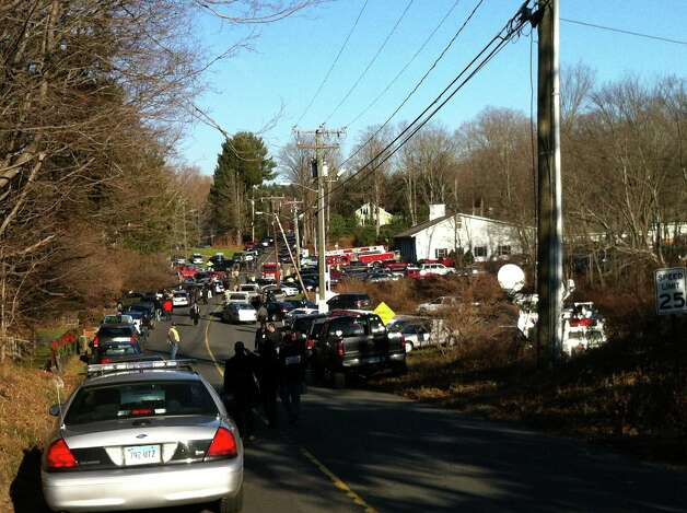 The scene at Sandy Hook Fire Station as part of the response to a multiple shootings at Sandy Hook Elementary School in Newtown, Conn. on Friday, Dec. 14, 2012. Twenty-nine people including 22 children were massacred in a horrific bloodbath at the Sandy Hook Elementary School this morning, sources told the Associated Press. The gunman is dead, police said. Few other details were immediately available, and other reports contradicted those numbers. Photo: Christian Abraham / Connecticut Post