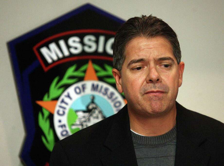 In this Wednesday, Dec. 12, 2012 photo, Mission Police Chief Martin Garza speaks to the media during a news conference at Mission Police Department in Mission, Texas. Three South Texas lawmen, including the son of a prominent county sheriff, will likely spend the weekend in custody on charges alleging that they and another officer accepted thousands of dollars in bribes to guard shipments of cocaine. Federal agents Wednesday arrested Jonathan Trevino, son of Hidalgo County Sheriff Lupe Trevino, and Alexis Espinoza, son of Hidalgo Police Chief Rudy Espinoza, three area law enforcement officials confirmed. (AP Photo/The Monitor, Joel Martinez) Photo: Joel Martinez, MBO / The Monitor