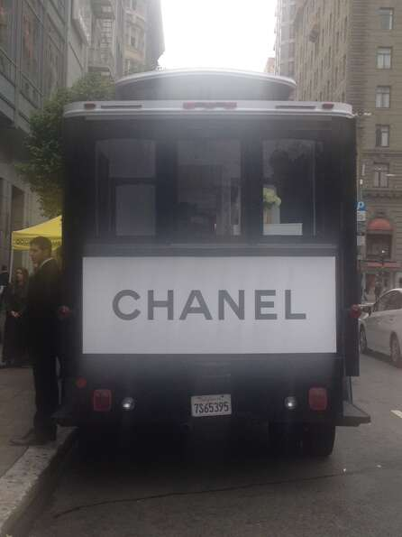 The Chanel-clad cable car is parked on Geary Street right outside the main entrance to Macy's on Uni