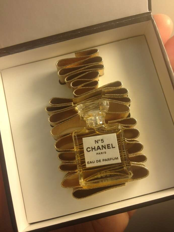 The sample gift is a miniature version of the iconic bottle.
