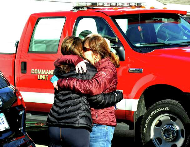 Parents of Sandy Hook Elementary School students console each other outside the Sandy Hook Firehouse after shootings at the school on Friday, Dec. 14, 2012. Photo: Michael Duffy / The News-Times