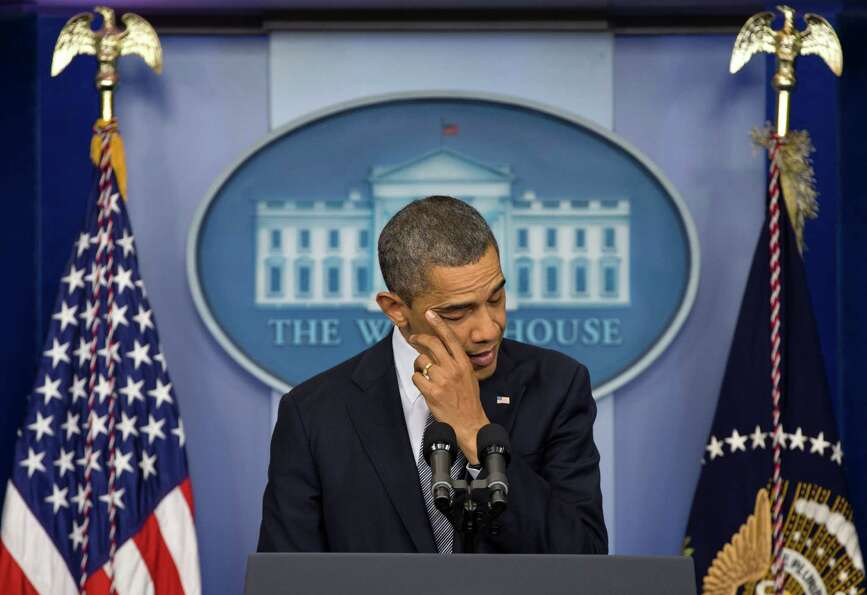 President Barack Obama wipes his eye as he talks about the Connecticut elementary school shooting, F