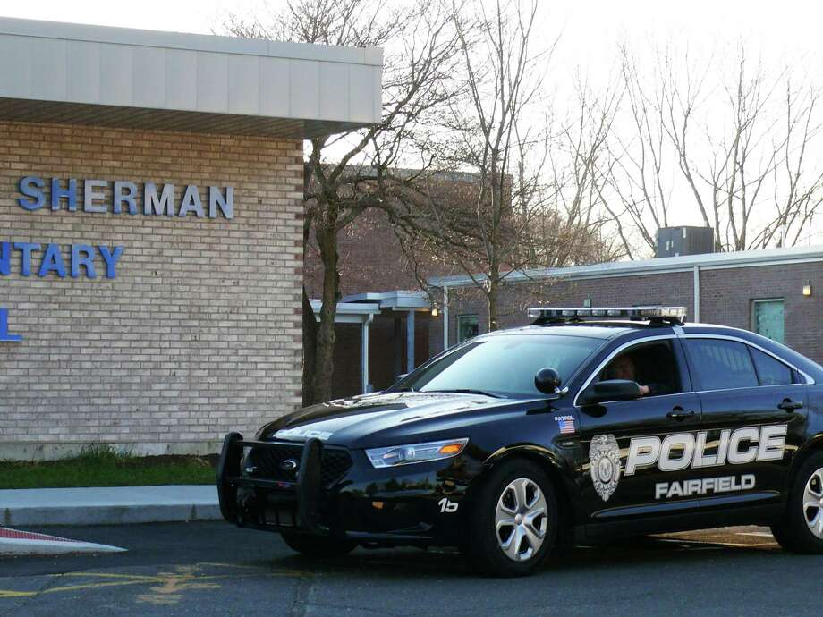Police increased patrols at dismissal time at all schools in the wake of the tragedy in Newtown. Photo: Genevieve Reilly / Fairfield Citizen