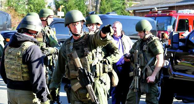 State Police group outside the Sandy Hook Firehouse after shootings at the Sandy Hook Elementary School on Friday, Dec. 14, 2012. Photo: Michael Duffy / The News-Times