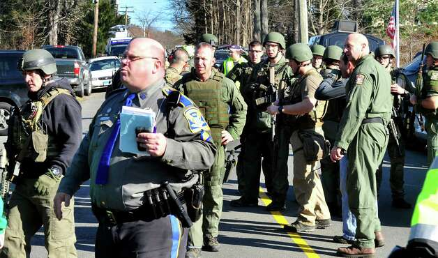 State Police group outside the Sandy Hook Firehouse after shootings at the Sandy Hook Elementary School Friday, Dec. 14, 2012. Photo: Michael Duffy / The News-Times