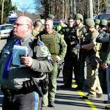State Police group outside the Sandy Hook Firehouse after shootings at the Sandy Hook Elementary School Friday, Dec. 14, 2012.