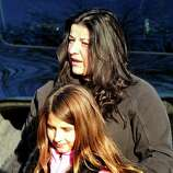 Alberta Bajraliu hugs her daughter, Venesa, 9, after shootings at the Sandy Hook Elementary School Friday, Dec. 14, 2012. Venesa was in her fourth grade art class at the time of the shootings.