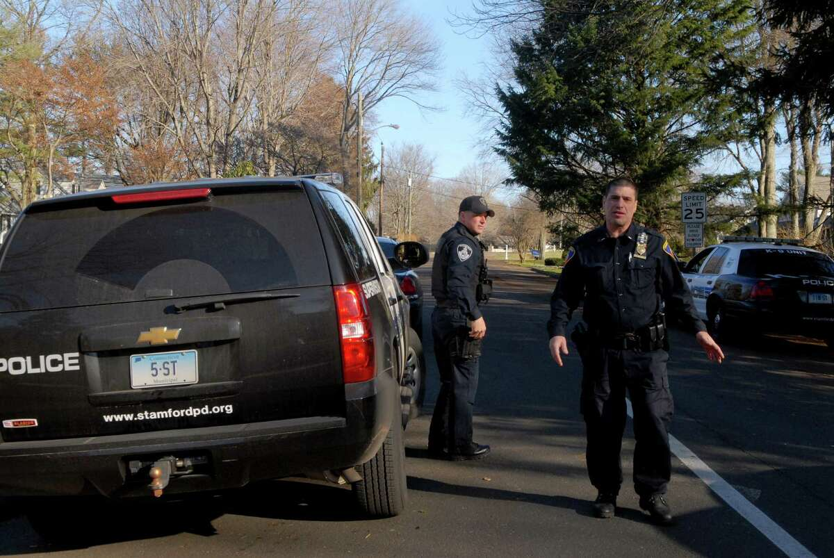 The Stamford Police check out a home on Bartina Lane in Stamford, Conn. belonging to Peter Lanza the father of Adam Lanza who is the alleged shooter at Sandy Hook Elementary School in Newtown, Conn on Friday December 14, 2012 where 26 were killed including 20 children.