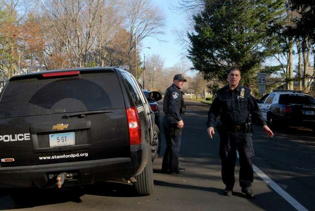 The Stamford Police check out a home on Bartina Lane in Stamford, Conn. belonging to Peter Lanza the father of Ryan Lanza who is the alleged shooter at Sandy Hook Elementary School in Newtown,  Conn on Friday December 14, 2012 where 26 were killed including 20 children. Photo: Dru Nadler / Stamford Advocate Freelance