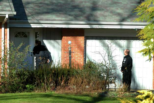 The Stamford Police check out a home on Bartina Lane in Stamford, Conn., belonging to Peter Lanza, the father of Adam Lanza, the alleged shooter at Sandy Hook Elementary School in Newtown,  Conn., on Friday, Dec. 14, 2012. Photo: Dru Nadler / Stamford Advocate Freelance