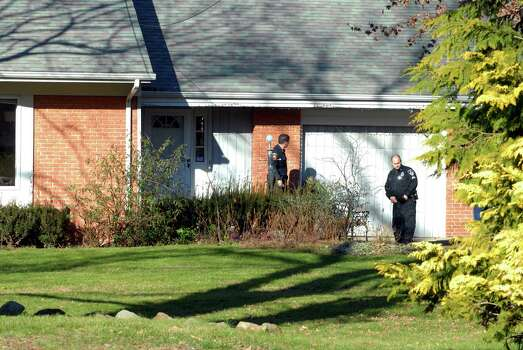 The Stamford Police check out a home on Bartina Lane in Stamford, Conn. belonging to Peter Lanza the father of Ryan Lanza who is the alleged shooter at Sandy Hook Elementary School in Newtown,  Conn on Friday December 14, 2012 where 26 were killed including 20 children Photo: Dru Nadler / Stamford Advocate Freelance