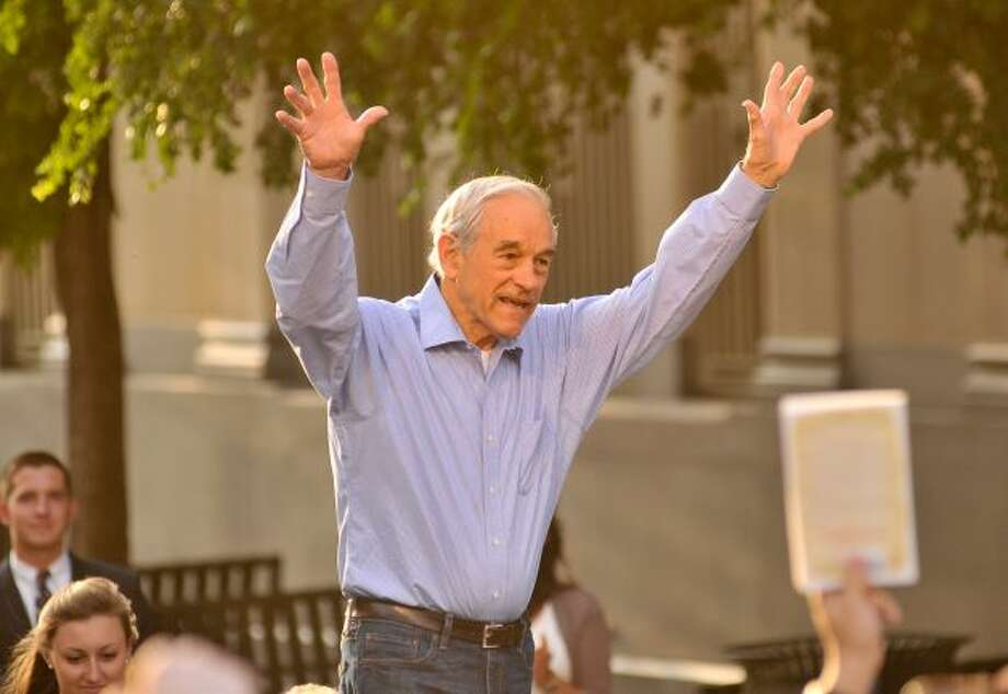 GOP presidential candidate Ron Paul waves to supporters at a rally in Main Plaza on Thursday, April 12, 2012.